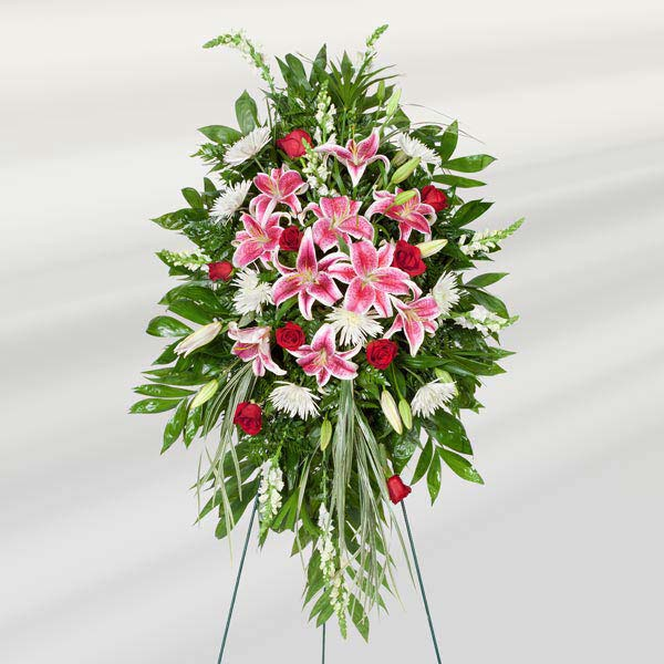pink floral funeral tribute on easel
